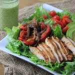 My PCOS Kitchen - Paleo Fajitas Salad - A delicious salad made with homemade taco seasoning and homemade cilantro dressing! Gluten-free
