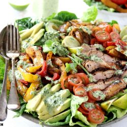 Keto Low Carb Chicken Fajita Salad - My PCOS Kitchen - A fajita salad with grilled chicken and veggies with a creamy cilantro dressing.