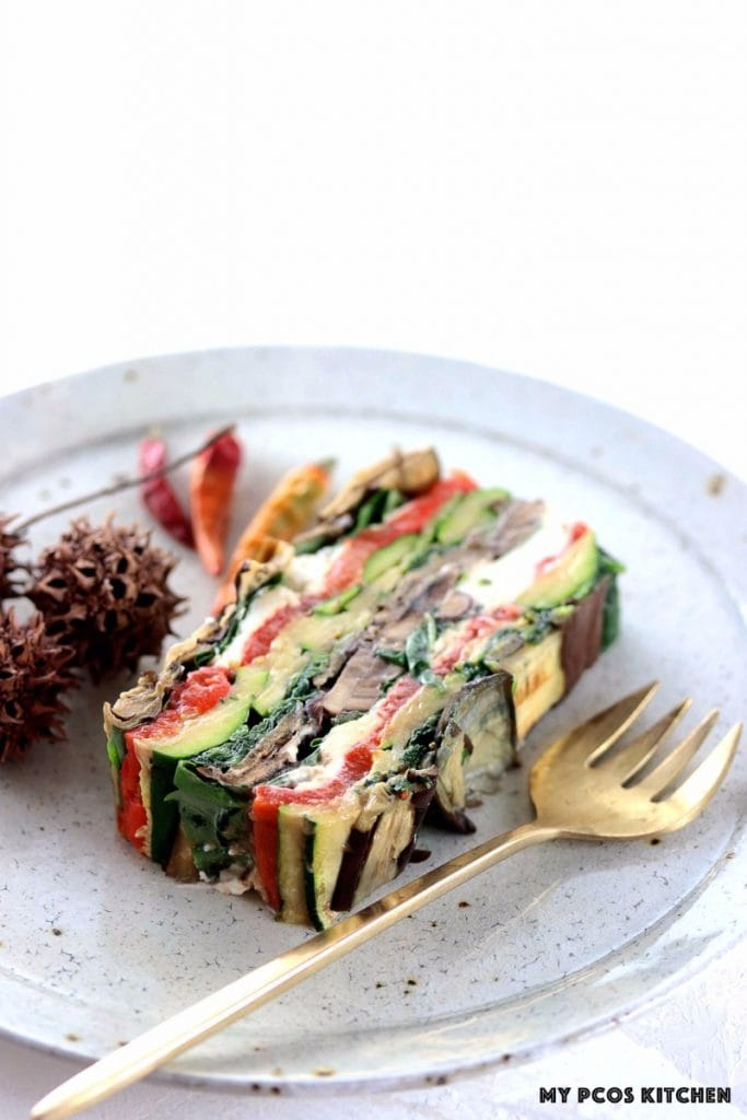 My PCOS Kitchen - Roasted Vegetable Terrine - Grilled veggie terrine on white handmade ceramic plate and gold brass spoon.