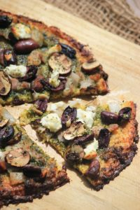 GF Cauliflower Pesto Pizza with Olives and Goat Cheese
