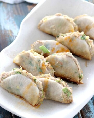 Japanese potstickers dipping sauce drizzled over healthy potstickers