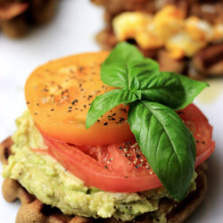 Paleo Avocado Waffle Toast with some tomatoes and fresh basil. The perfect gluten-free and low carb waffles for either breakfast or lunch!