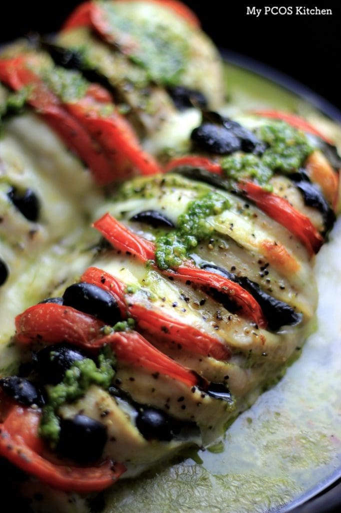 My PCOS Kitchen - Hasselback Chicken Caprese - A chicken breast sliced and stuffed with fresh mozzarella, pesto, tomatoes, basil and olives. Keto/low carb