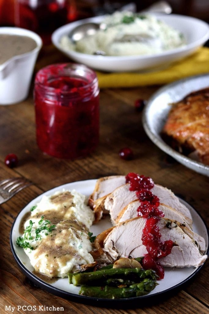 My PCOS Kitchen - Keto Thanksgiving Turkey - Thanksgiving meal with sliced turkey breast, sugar-free cranberry sauce, giblet gravy and mashed cauliflower.