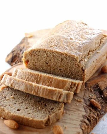 My PCOS Kitchen - Low Carb Paleo Bread with Almond Butter - This gluten-free keto bread is grain-free and dairy-free. Sliced bread over an olive wood cutting board.