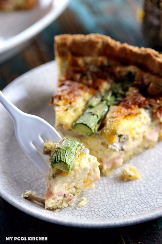 My PCOS Kitchen - Low Carb Quiche with Mascarpone & Asparagus - A white fork with a small piece of the creamy gluten-free quiche.