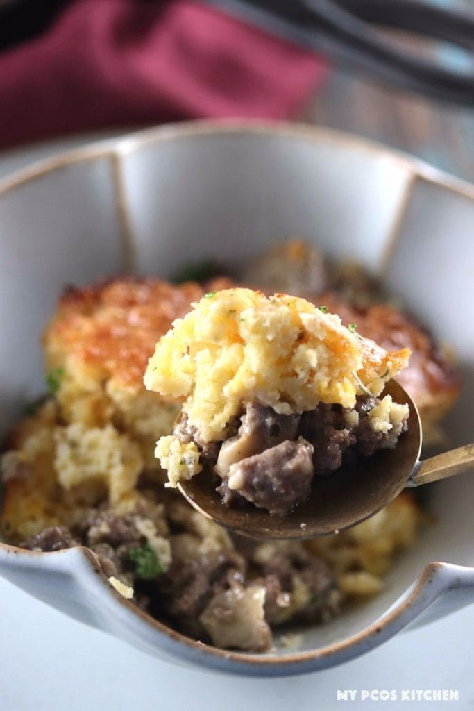 My PCOS Kitchen - Low Carb Sausage Gravy & Biscuits Skillet - A brass spoonful of sausage gravy and low carb biscuits over.
