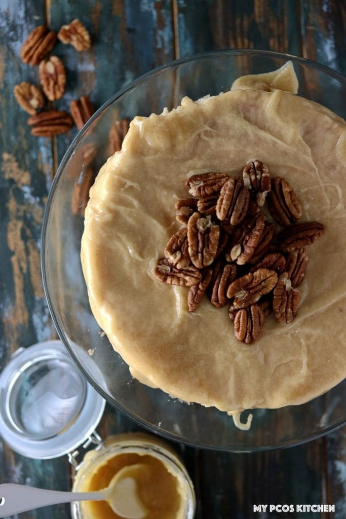 Sugar Free Cheesecake with Caramel - My PCOS Kitchen - Overhead shot of a caramel cheesecake topped with pecan nuts.