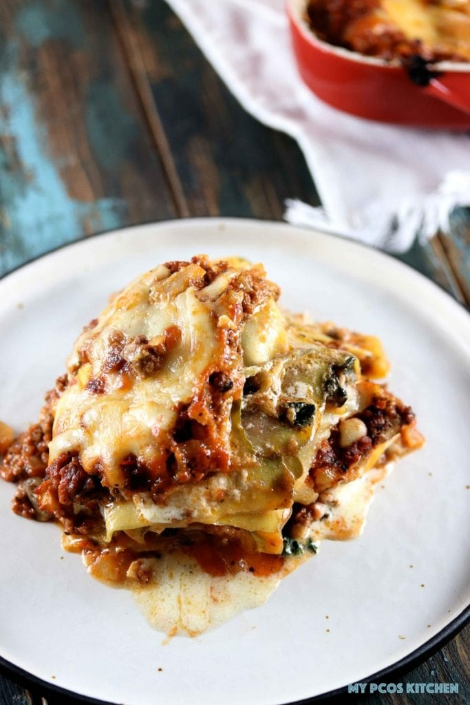Low Carb Zucchini Lasagna - My PCOS Kitchen - Two slices of lasagna stacked together. All gluten-free because of zucchini lasagna noodles. Kitchenaid vegetable sheet cutter attachment zucchini lasagna noodles.
