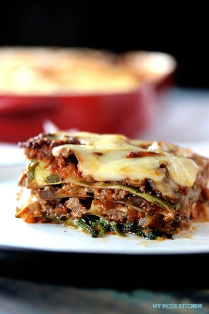 Low Carb Lasagna with Zucchini Noodles - My PCOS Kitchen - A delicious sugar-free tomato meat sauce served over zucchini lasagna noodles and cheese.