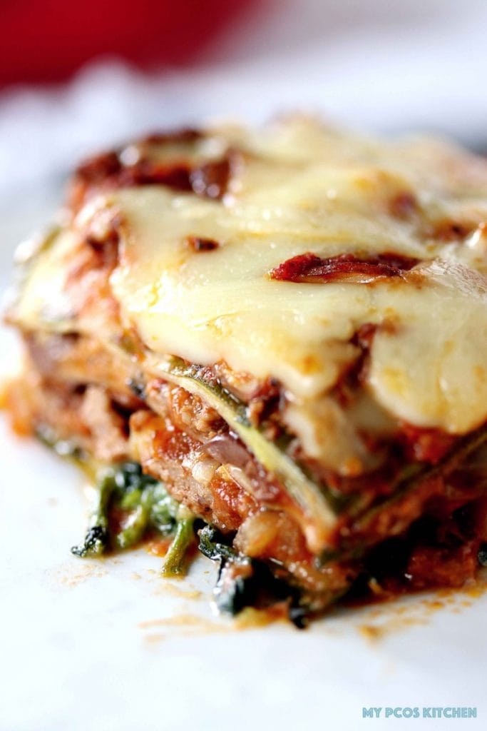 Low Carb Lasagna with Zucchini Noodles - My PCOS Kitchen - A closeup shot of the zucchini noodles lasagna sheets. Meaty tomato sauce with cheese.