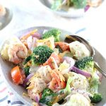 Amish Broccoli Cauliflower Salad with Shrimps - My PCOS Kitchen - A delicious creamy salad made with healthy vegetables and shrimp. Two small bowls of salad in the background.