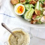 My PCOS Kitchen - Low Carb Homemade Caesar Salad Dressing - Large caesar salad with a batch of homemade sugar-free caesar dressing.