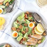 Low Carb Caesar Salad with Chicken - My PCOS Kitchen - An overhead shot of a chicken caesar salad with bacon, gluten free croutons and eggs.