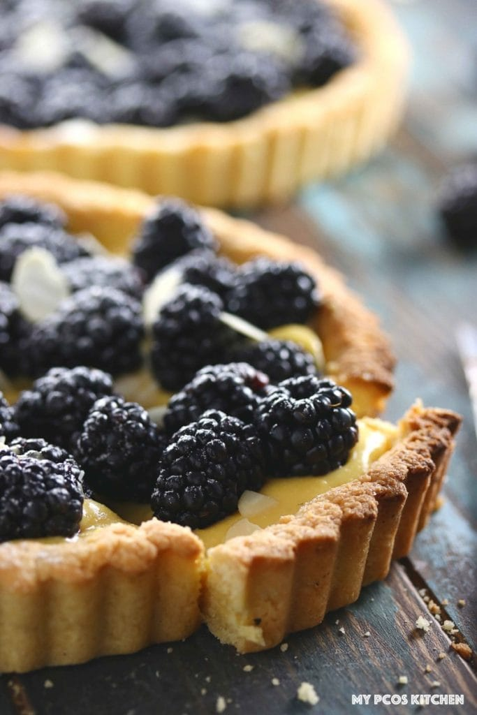 How to make Lemon Curd - Low Carb Lemon Blackberry Tart - My PCOS Kitchen - A gluten-free low carb crust in a tart shape that holds lemon curd and blackberries.