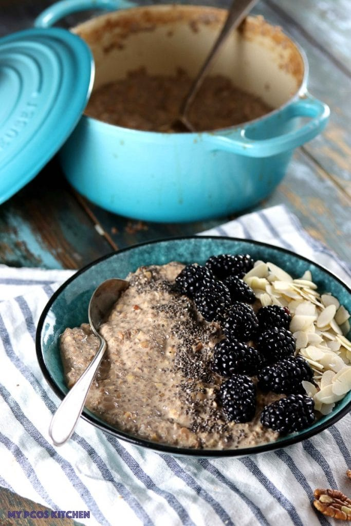 Maple Low Carb Oatmeal - My PCOS Kitchen - Bowl of oatmeal with a marine blue le creuset cast iron enamel coated dutch oven.