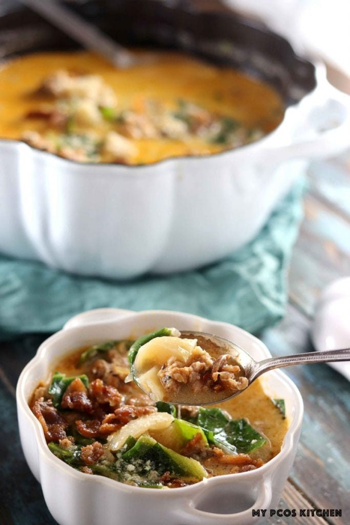 Low Carb Olive Garden Zuppa Toscana - My PCOS Kitchen - A silver spoon filled with soup