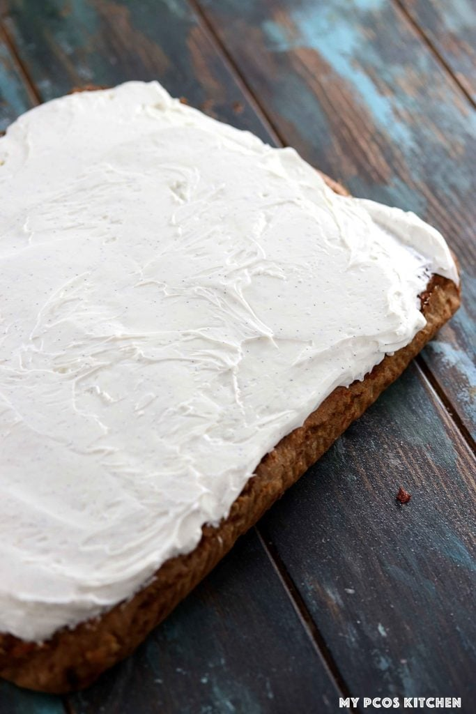 Healthy cream cheese frosting topped over an entire carrot cake.