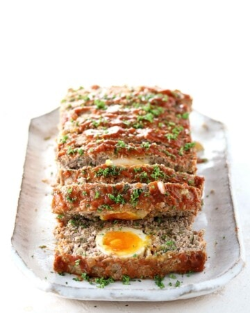 Keto Meatloaf with Eggs - My PCOS Kitchen - Slices of meatloaf covered in Heinz reduced sugar ketchup.