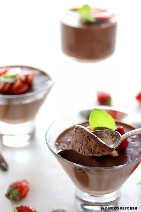 Keto Chocolate Mousse - My PCOS Kitchen - A creamy low carb chocolate moussed made with unsweetened chocolate and coconut milk! A spoon full of chocolate.
