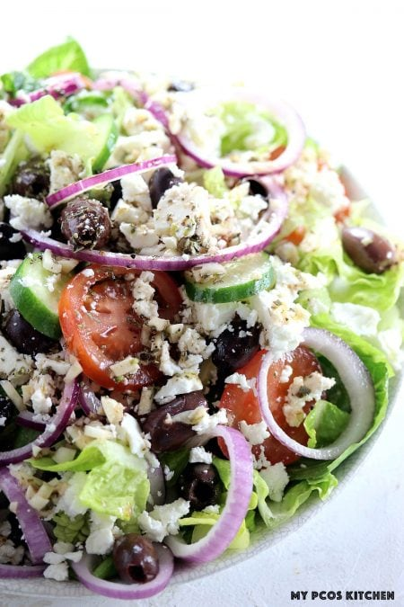 Authentic Greek Salad - My PCOS Kitchen - A traditional Greek salad dressing topped over the best greek salad recipe!