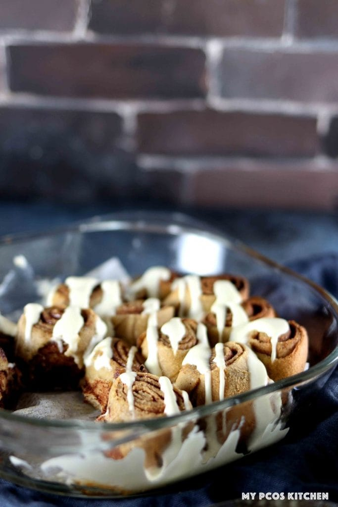 soft and chewy keto cinnamon rolls in a glass baking dish.