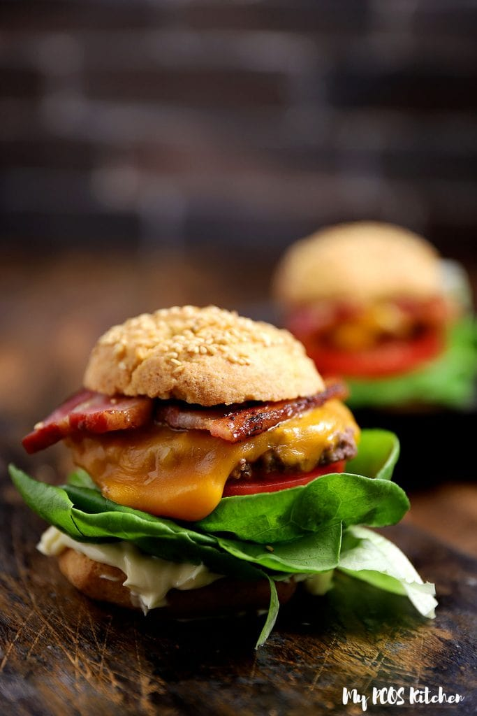 A bacon cheeseburger served on some low carb buns.