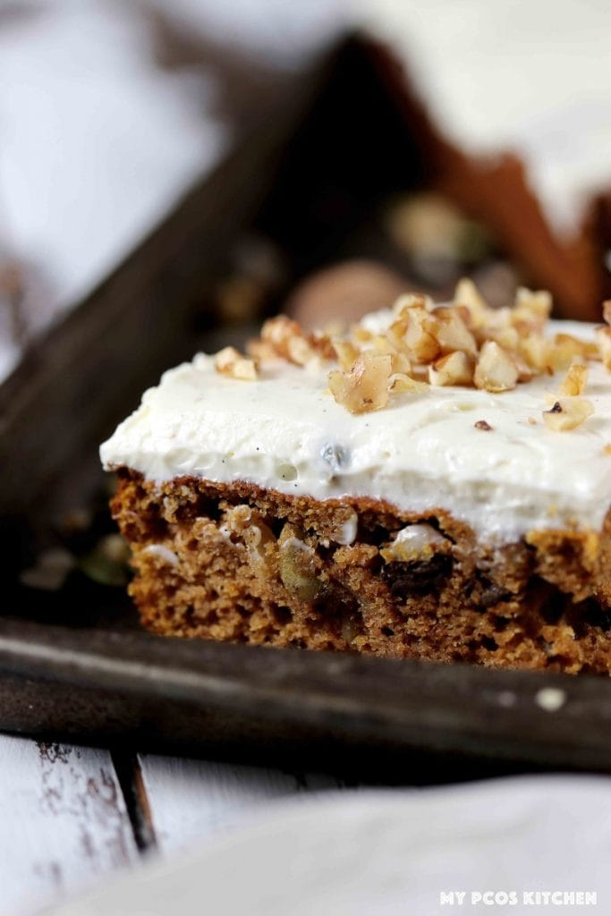 A closeup of a gluten free pumpkin bar topped with cream cheese frosting.