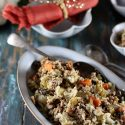 Low carb cauliflower stuffing in a ceramic blue serving bowl.
