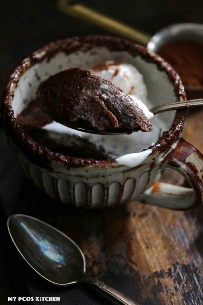 A spoonful of sugar free chocolate cake made from a 2 minute mug cake.