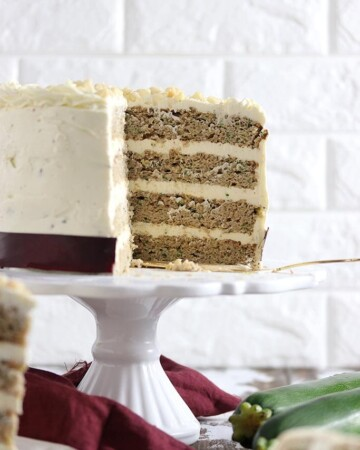 A cream cheese frosted four layer zucchini cake