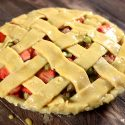 A simple egg wash over a cream cheese pie crust with a lattice design.