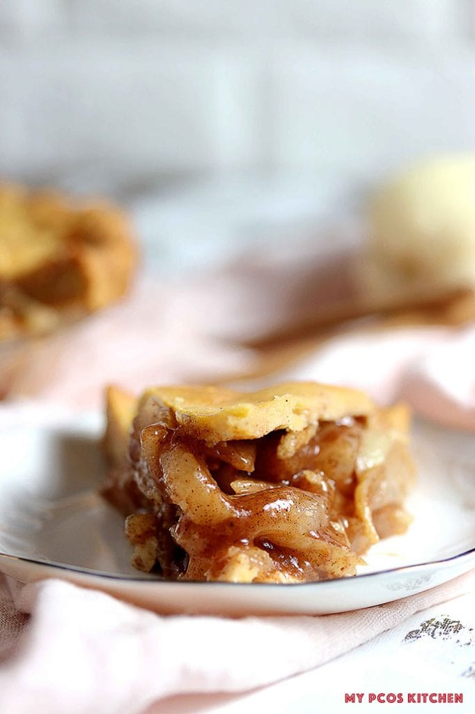 Keto Apple Pie Filling drooling out of an apple pie slice.