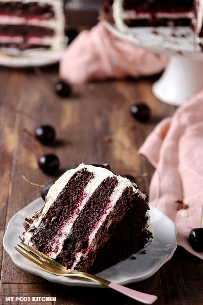 A slice of gluten free black forest cake filled with raspberry filling