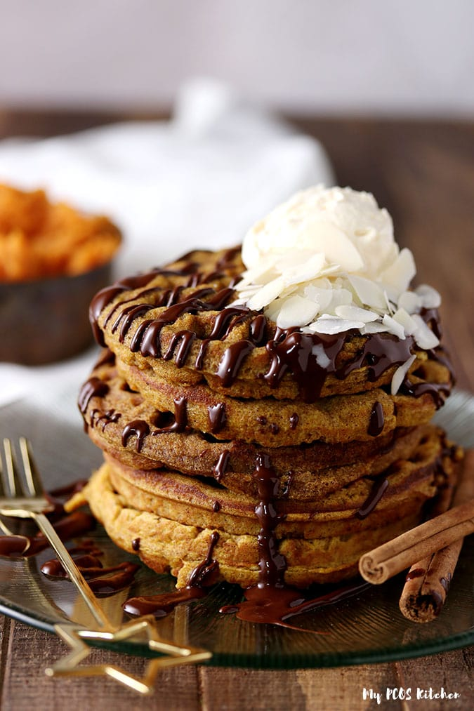 Keto Pumpkin waffles loaded with pumpkin whipped cream and sugar free melted chocolate.