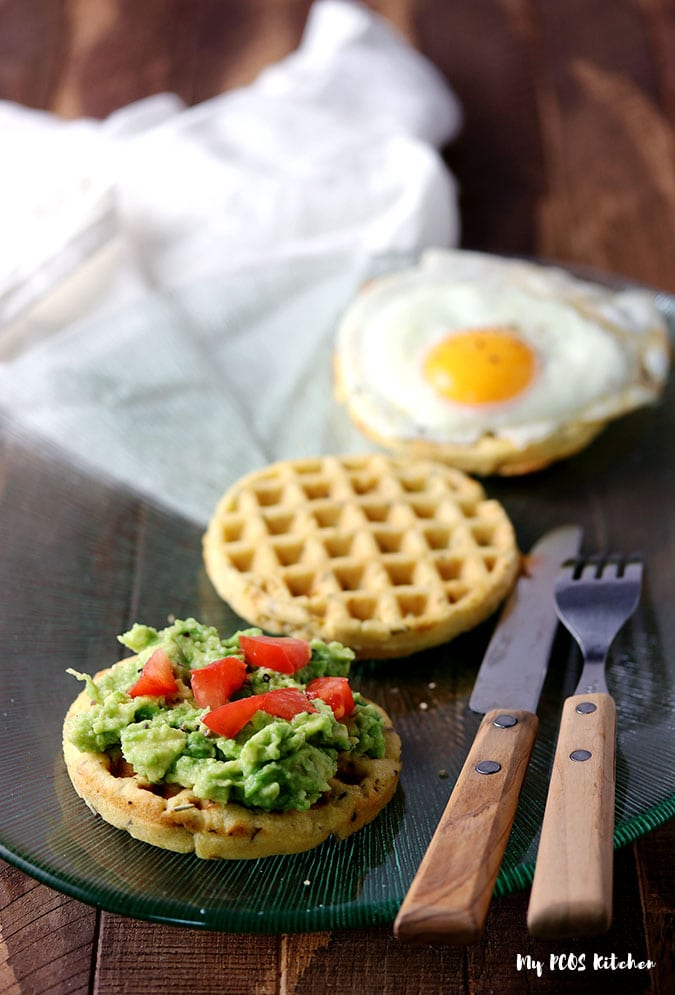 Gluten free waffle toasts with avocado and sunny side up egg.