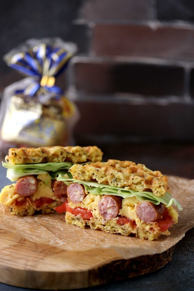 Low carb waffle made into a sandwich with eggs and sausage.