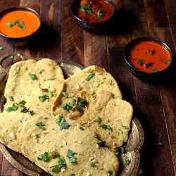 Gluten free naan bread recipe in a copper platted ready to be dipped in Indian curries.