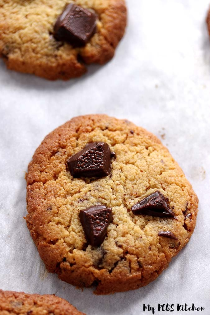 An low carb chocolate chip cookie made with allulose and almond flour topped with sugar free chocolate.