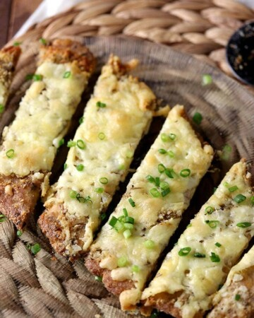 Slices of keto garlic bread with cheese cut into breadsticks.
