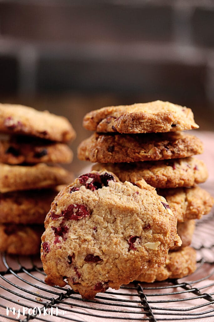 Cranberry Oatmeal cookies stacked up on top of one another.