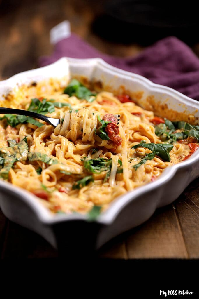 Baked feta pasta in a baking dish baked in an oven.