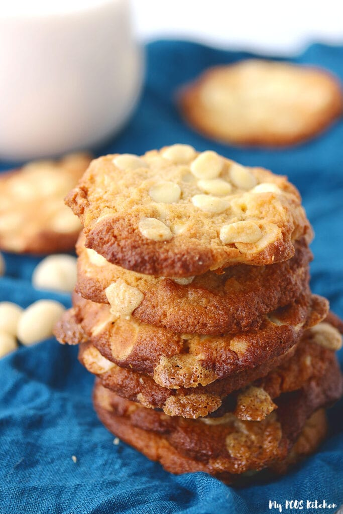 A stack of perfectly baked white chocolate macadamia nut cookies made gluten free and sugar free.